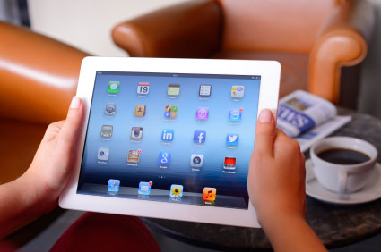 man holding an iPad while testing an application being developed